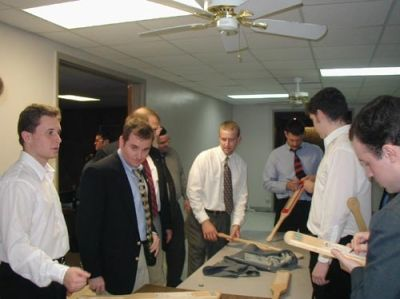 Xi Installation 2003-Dan Lawrie '92 supervises as the new brothers make paddles