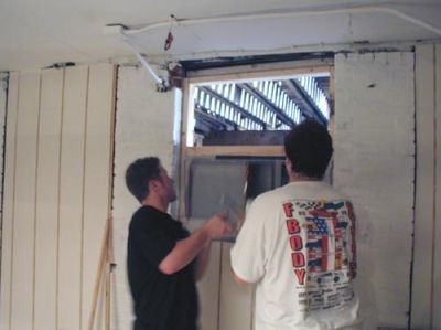 Work Week 2003- Kent Smith and Bill Cleary '82 install an AC unit in the new pool room