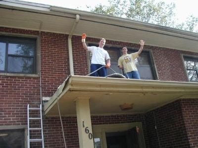 Work Week 2003- The brothers clean the roof and gutters for work week