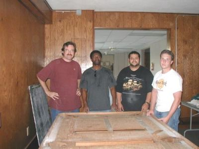 Bill Cleary '82, Bob Washington, Richard Grubel and Kent Smith recover after moving the old pool table back to the house (May 30, 2003)